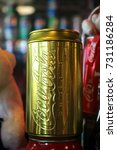 Small photo of Rayong, Thailand - April 8th, 2017: A collectible all-gold Coca-Cola can, a limited edition themed around the company's sponsorship of the Olympic Games, found in a memorabilia collection, Rayong.
