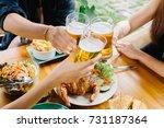 group of friends enjoying a... | Shutterstock . vector #731187364