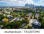 Small photo of West of downtown suburb near Montrose with the downtown skyline of Houston , Texas in the distance