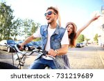 happy funny young couple riding ... | Shutterstock . vector #731219689
