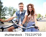 Happy Funny Young Couple Riding ...