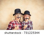 funny woman and kid with fake... | Shutterstock . vector #731225344