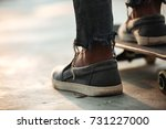 close up of skateboarders feet... | Shutterstock . vector #731227000