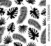 seamless pattern with black... | Shutterstock .eps vector #731304340