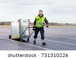 worker pulling machine on cart... | Shutterstock . vector #731310226
