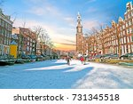 Stock photo amsterdam in winter with the westerkerk in the netherlands at sunset 731345518