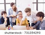 group of young asian colleagues ... | Shutterstock . vector #731354293