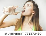 drinking water woman on a white ... | Shutterstock . vector #731373490