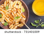 grilled pineapple with mint and ... | Shutterstock . vector #731401009