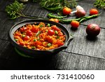 indian tomato curry with herbs... | Shutterstock . vector #731410060