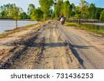 Dirt Road With A Hole Along Th...