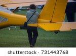 Small photo of Concentrated young aircraftsman repairing his small aircraft