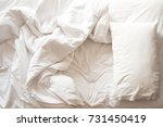 messy bed. white pillow with... | Shutterstock . vector #731450419