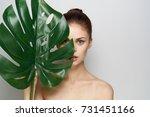 spa procedure  woman holding a...   Shutterstock . vector #731451166