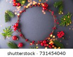 frame with christmas wreath on... | Shutterstock . vector #731454040