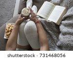 closeup of woman reading book... | Shutterstock . vector #731468056