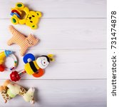 baby toys on wooden background | Shutterstock . vector #731474878