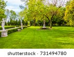 an antique statue by tree lined ... | Shutterstock . vector #731494780