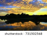 sunset in sky beautiful colorful landscape silhouette tree woodland and river reflect the twilight time