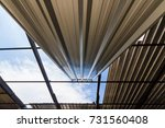gray metal sheets roofing are... | Shutterstock . vector #731560408