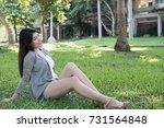 pretty asian woman portrait.... | Shutterstock . vector #731564848