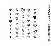 set of grungy hand drawn hearts.... | Shutterstock .eps vector #731592220