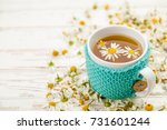 cup of chamomile tea | Shutterstock . vector #731601244