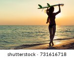 Surfer Girl Surfing Looking At...