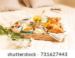 continental breakfast on bed in ... | Shutterstock . vector #731627443