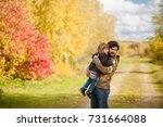 father and daughter walking... | Shutterstock . vector #731664088