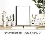 modern desk with plants in... | Shutterstock . vector #731675470