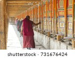 tibet monk prayer wheels | Shutterstock . vector #731676424