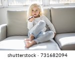 a 4 years old child watching tv ... | Shutterstock . vector #731682094