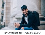 smiling happy teenager or young ... | Shutterstock . vector #731691190