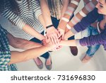 group of young people hands... | Shutterstock . vector #731696830