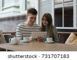young nice couple sitting in... | Shutterstock . vector #731707183