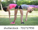 women doing stretching   Shutterstock . vector #731717950