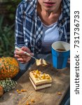 the girl is eating cake and... | Shutterstock . vector #731736733