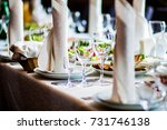 glasses on banquet table | Shutterstock . vector #731746138