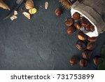 chestnuts in a jute basket on a ... | Shutterstock . vector #731753899