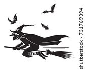 flying witch and bats... | Shutterstock .eps vector #731769394