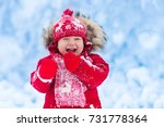 baby playing with snow in... | Shutterstock . vector #731778364