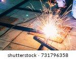 man worker manual welding on... | Shutterstock . vector #731796358