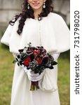 bride holding bouquet of fresh... | Shutterstock . vector #731798020