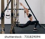 sporty woman doing trx... | Shutterstock . vector #731829094