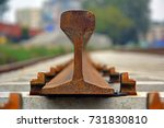 Small photo of Construction of a new railway line. close-up of a new rusty rail head