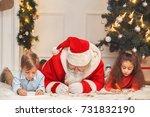 santa claus with kids indoors...   Shutterstock . vector #731832190
