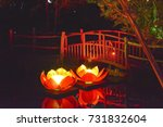a bridge illuminated by nearby... | Shutterstock . vector #731832604