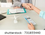close up of travel agent... | Shutterstock . vector #731855440