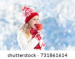 child eating candy apple on... | Shutterstock . vector #731861614